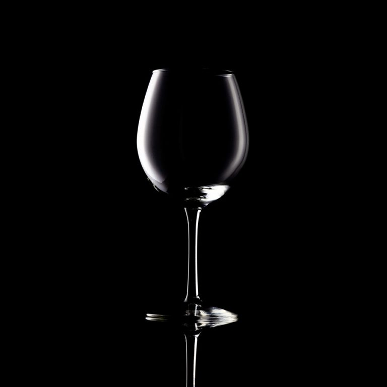 Wine glass contour on black - Advertisement