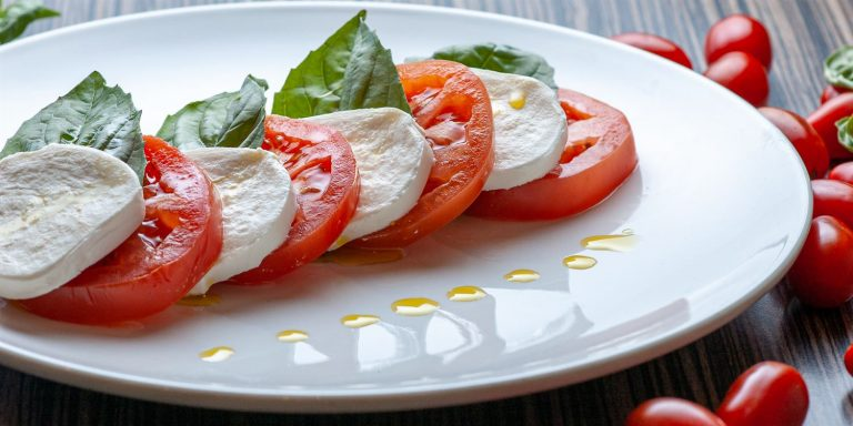 Caprese salad, mozzarella, tomato, basil - side view