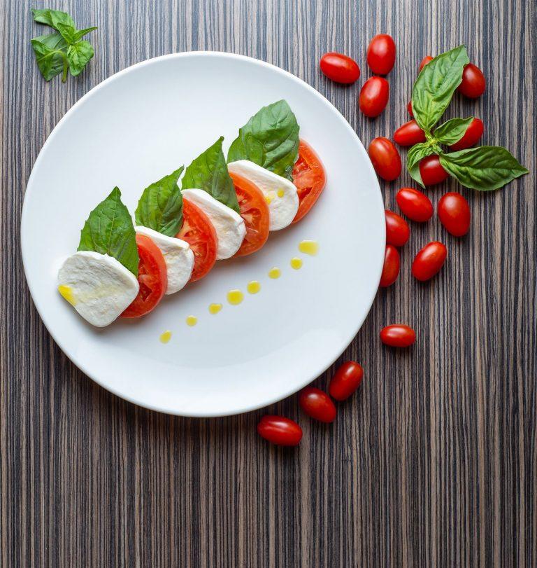 Caprese salad, mozzarella, tomato, basil - top view
