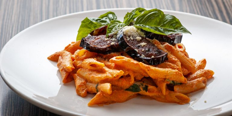 Penne alla norma, with ingredients - side view