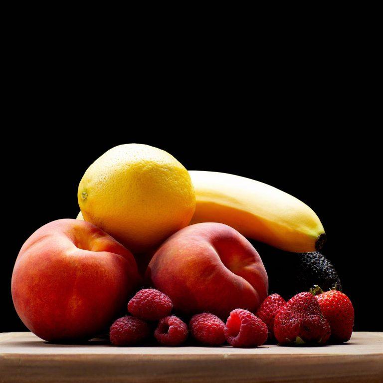 Fruit assortment on cutting board - side