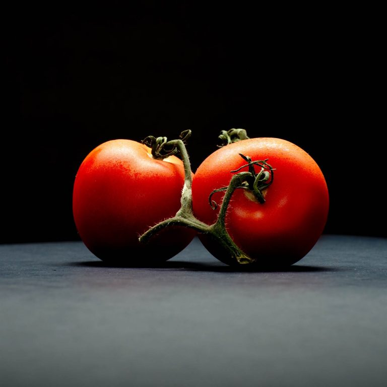 Tomatoes on table - side view